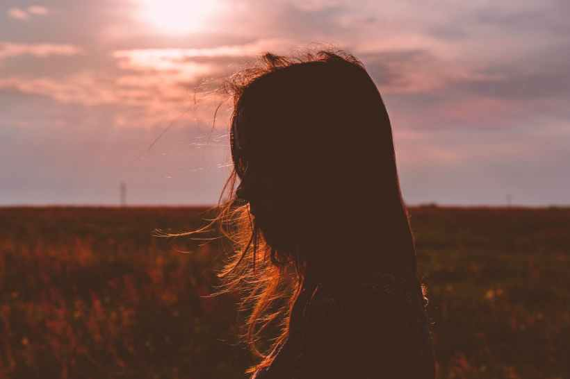 woman s silhouette photo during sunset
